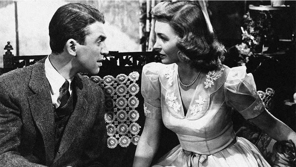 "Jimmy Stewart explains things to Donna Reed in ""It's a Wonderful Life"" 1946. (AP Photo)"