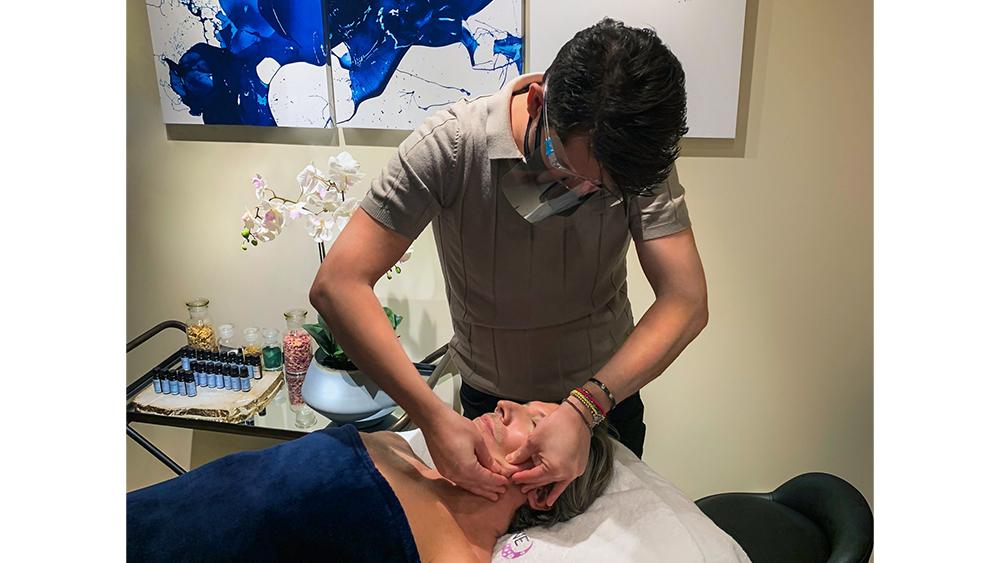 Pietro Simone administering his signature facial massage technique.