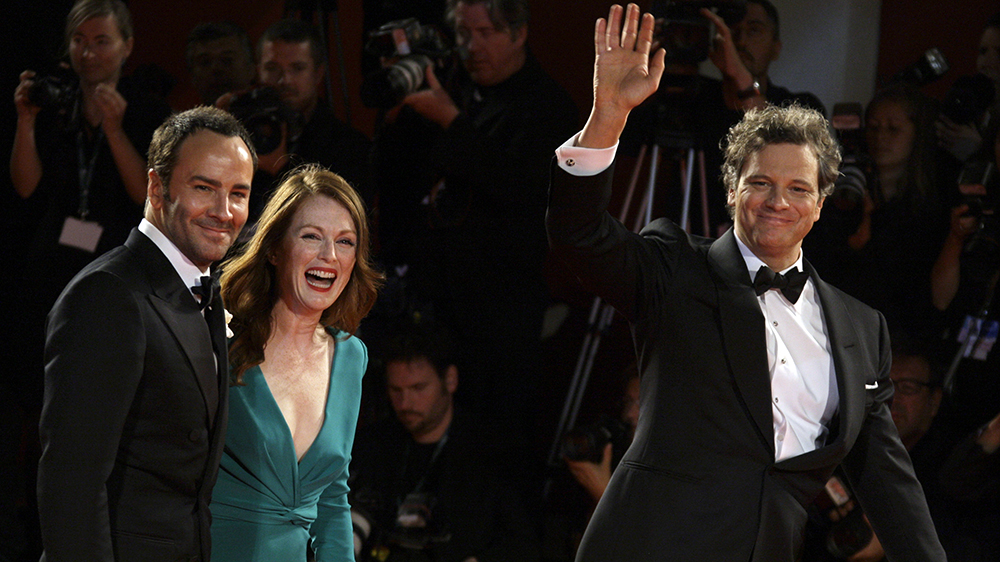 From left, U.S. director Tom Ford, U.S. actress Julianne Moore, and British actor Colin Firth, arrive for the premiere of the film ' A Single Man ' at the 66th edition of the Venice Film Festival in Venice, Italy, Friday, Sept. 11, 2009. (AP Photo/Joel Ryan)