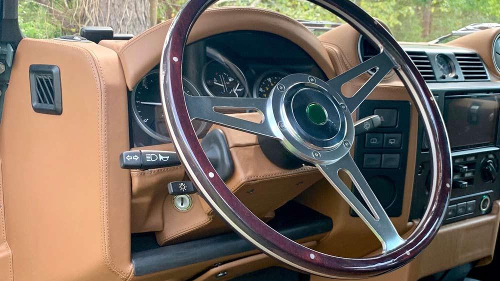 The interior of a restomod Land Rover Defender 110 from Osprey Custom Cars.