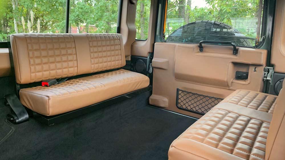 The rear interior of a restomod Land Rover Defender 110 from Osprey Custom Cars.