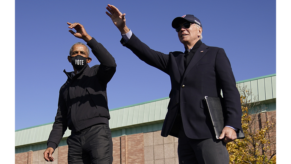 Democratic presidential candidate former Vice President Joe Biden, right, and former President Barack Obama, left, on stage together waving to the audience at a rally at Northwestern High School in Flint, Mich., Saturday, Oct. 31, 2020. (AP Photo/Andrew Harnik)