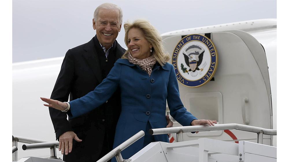 Vice President Joe Biden, accompanied by his wife Jill Biden, board Air Force Two, Tuesday, Nov. 6, 2012, at a Delaware Air National Guard Base in New Castle , Del., en route to Chicago. (AP Photo/Matt Rourke)