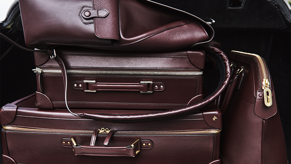 An assortment of Tanner Krolle luggage