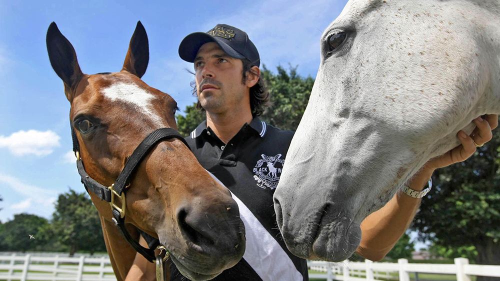 Nacho Figueras, 32, six goal international polo player with Black Watch polo team, at Black Watch farm along with Melva, (L), and Capocha Tuesday in Wellington.