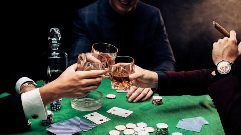 Men toasting at poker table