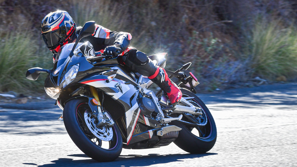 Riding Triumph's Daytona Moto2 765 motorcycle.