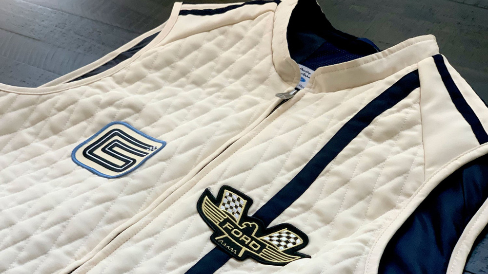 The Ford v. Ferrari Carroll Shelby Crew Vest, in white with blue stripes, from Original Venice Crew Apparel.