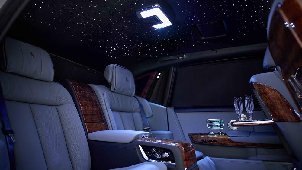 A bespoke Rolls-Royce Phantom with an interior that features Hawaiian Koa wood.