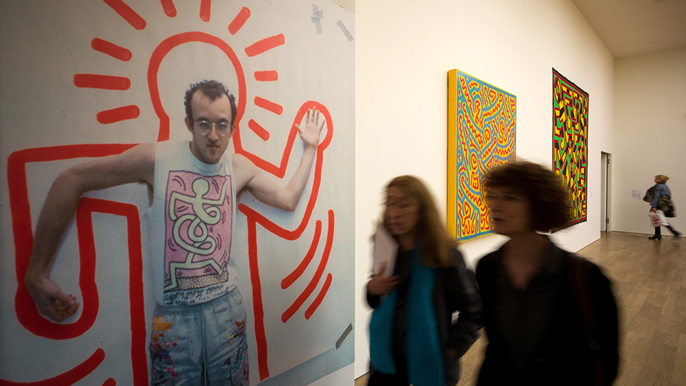 Visitors look around the exhibition 'Keith Haring - The Political Line' in Munich, Germany, 30 April 2015. The mostly large-format pictures and objects can be seen in the Kunsthalle of the Hypo-Cultural Foundation until 30 August 2015. The artist left most of his work untitled. Photo by: Peter Kneffel/picture-alliance/dpa/AP Images