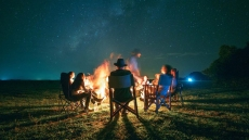 An evening around the campfire in Colombia, part of Pelorus's traverse of the Sierra Nevada by horseback, guided by the region's traditional cowboys.
