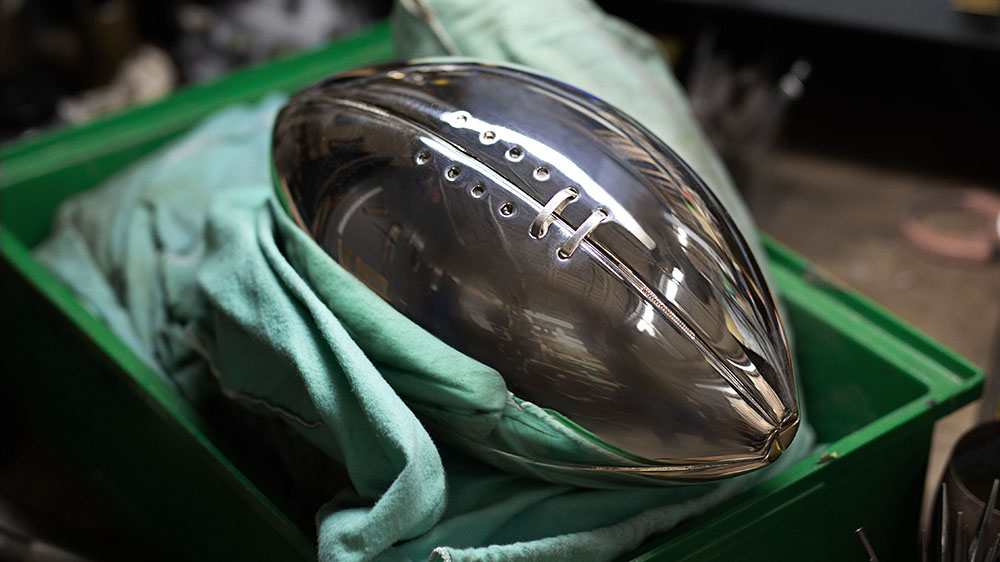 The sterling silver laces are applied to the regulation-size football.