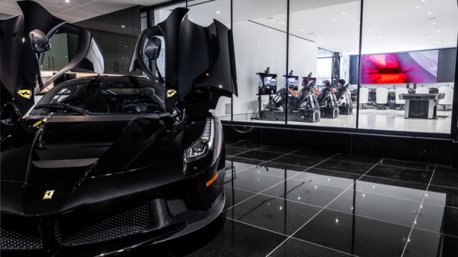 A look inside a Beverly Hills residence with three race simulators from CXC Simulations installed next to the owner's car collection.