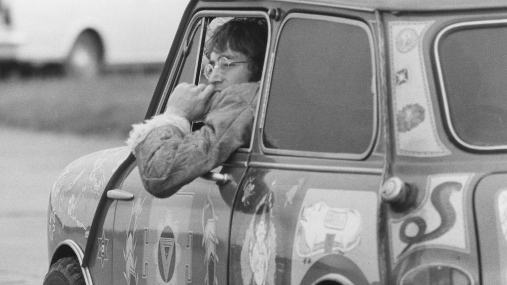 John Lennon seen in his bespoke Mini Cooper, circa the 1960s.