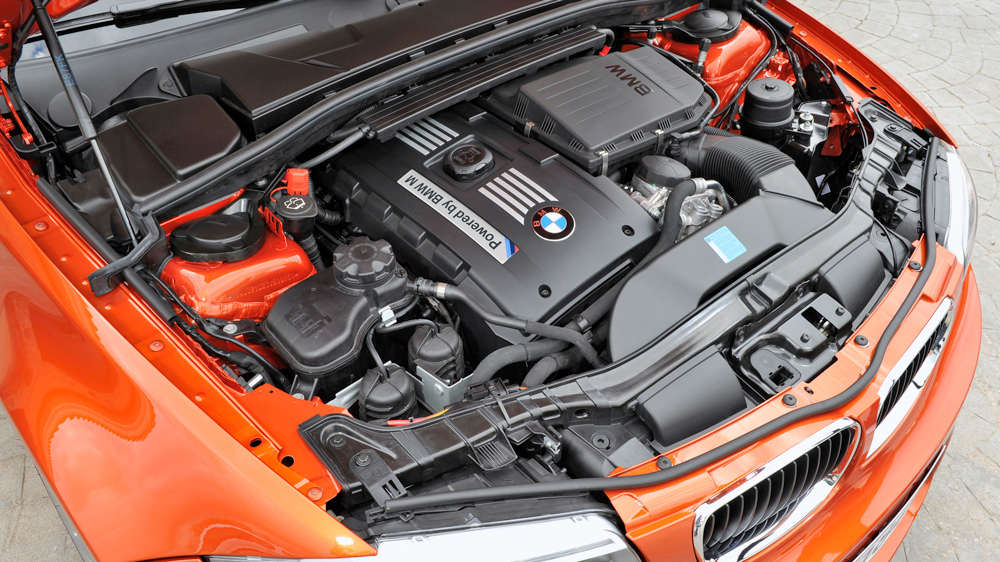 The 335 hp, 3.0-liter inline-six engine inside a 2011 BMW 1 Series M Coupe.