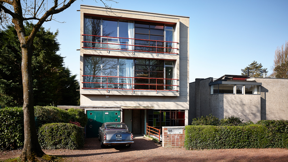 A Ferrari 250 GTE fronts a residence in Brussels designed by Belgian modernist architect Louis Herman De Koninck and built in 1924.