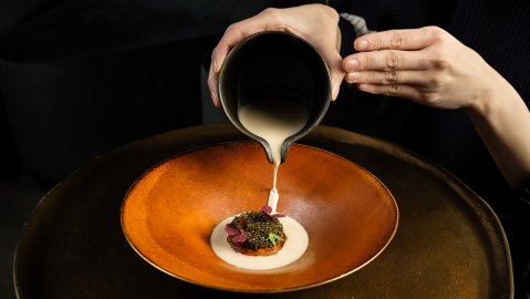 Winter squash with pumpkin-seed praline milk and Kaluga caviar at Atomix