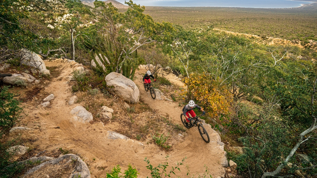 Riders climbing one of the hand-built trails