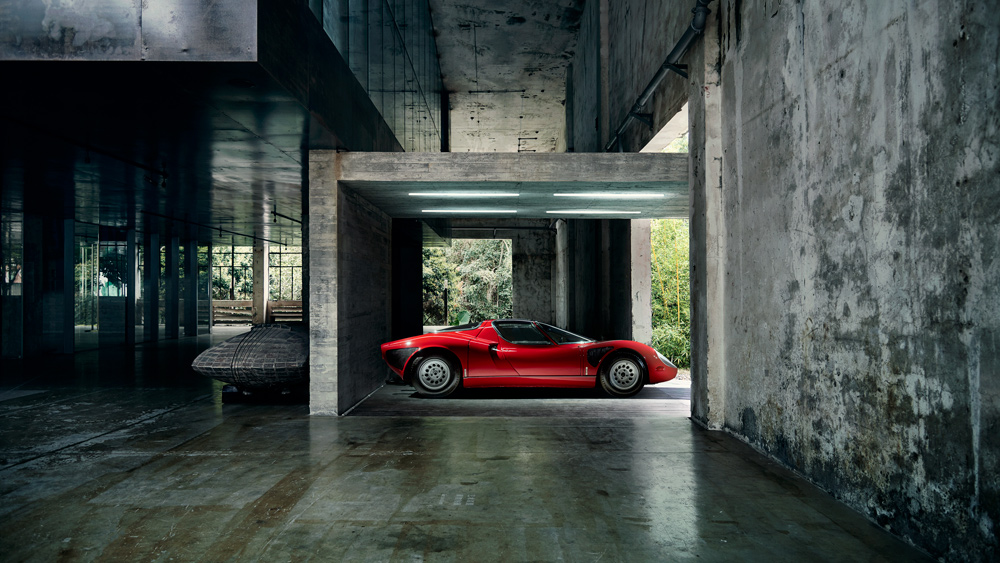 In Shenzhen, China, example of Alfa Romeo's seductive 33 Stradale from the 1960s sits in front of an art studio and exhibition complex designed by O-Office Architects.