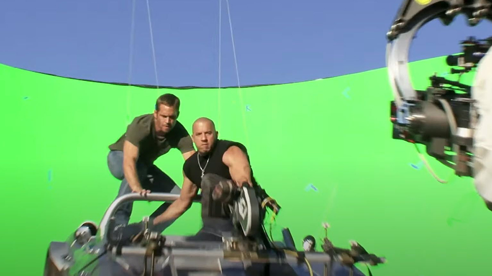 Vin Diesel and Paul Walker film the scene against a green screen