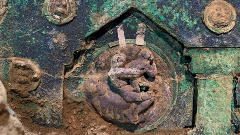 A closeup of the chariots bronze and tin decorations