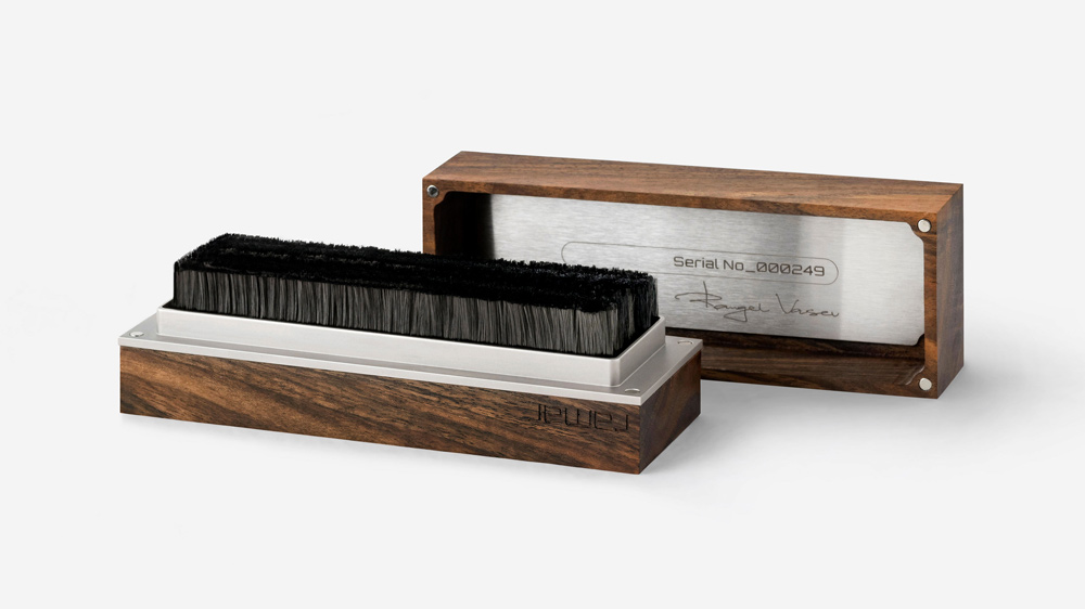 The Tina model of record brush from Ramar features a rich brown walnut with a filigreed grain pattern.