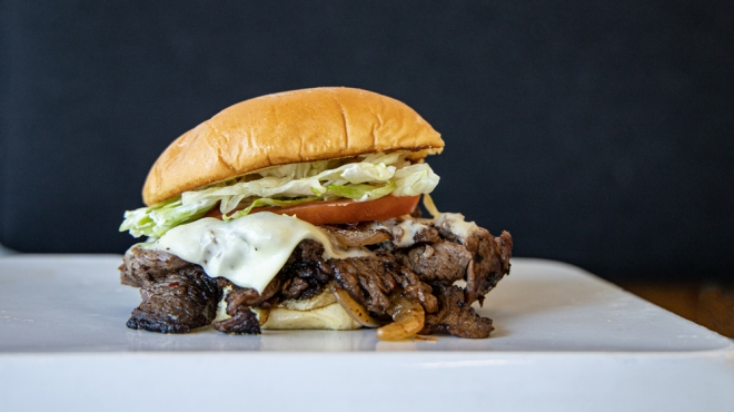 bbq prime rib sandwich with cheese and onions