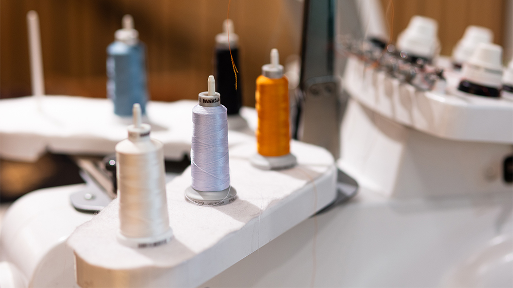 Spools of thread behind the scenes at a Savile Row tailor.