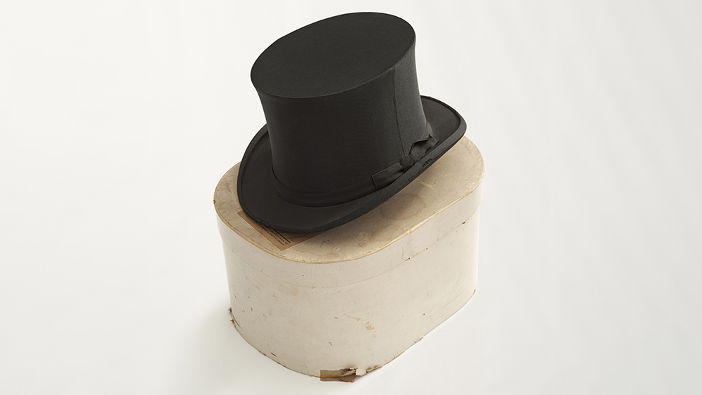 A circa-1930s collapsible silk opera hat, sourced by Crowley Vintage.