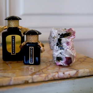 Two bottles of Cultus Artem's perfumes.