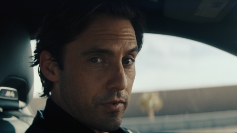"""A still of actor Milo Ventimiglia from a BMW """"Power of M"""" commercial."""