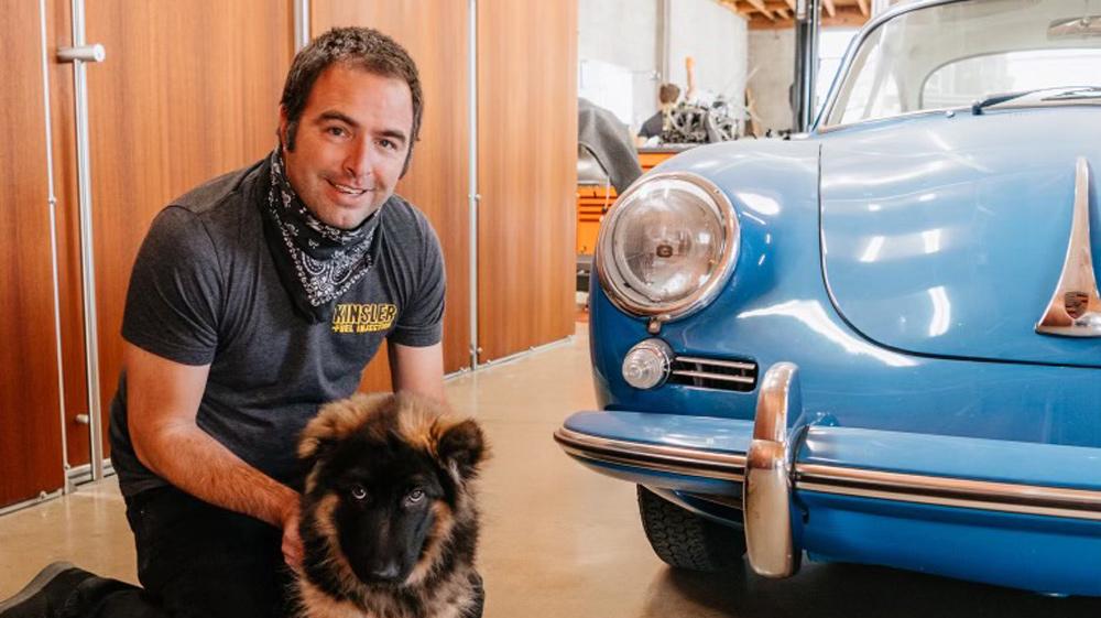 Marlon Goldberg, founder of automotive custom house Workshop 5001, and his dog Zander.