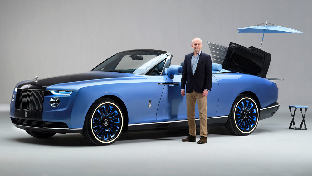 Automotive journalist Jeremy Taylor stands next to the 19-foot Rolls-Royce Boat Tail.