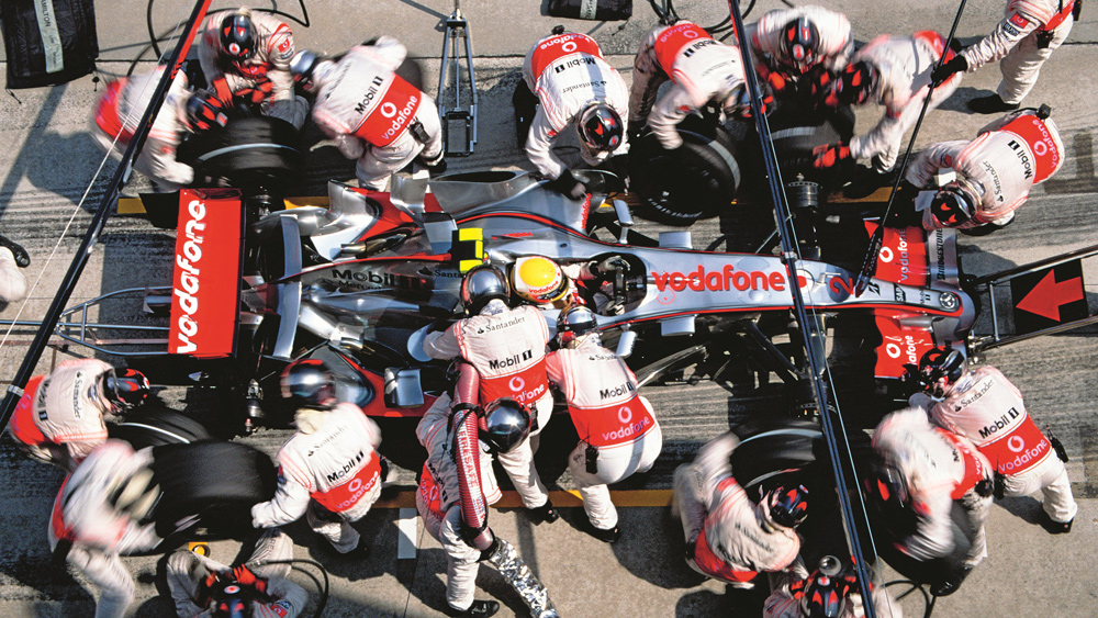 Racer Lewis Hamilton takes a pit stop during the second race of his rookie season in 2007.