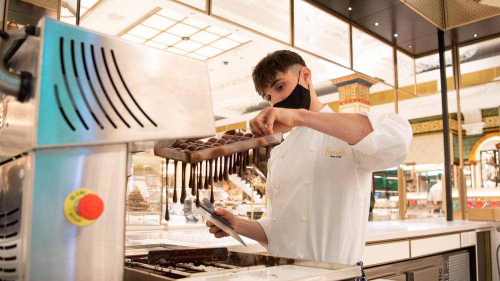 chocolatier making truffles by hand