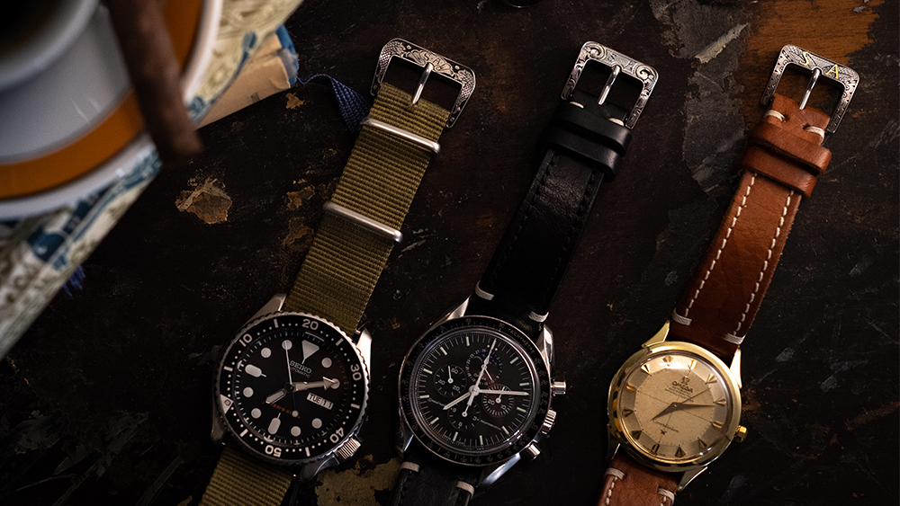 A selection of watch straps with custom engraved buckles by Jesús Serrato Lopez.