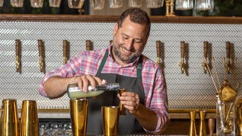 bartender mixing cocktail at bar