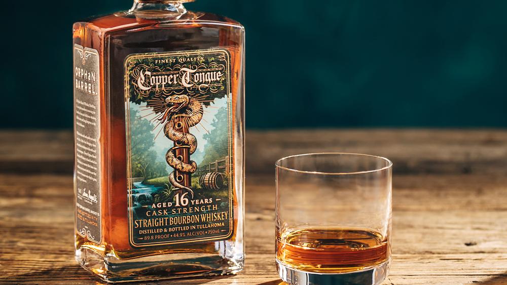 aged bourbon whiskey glass neat