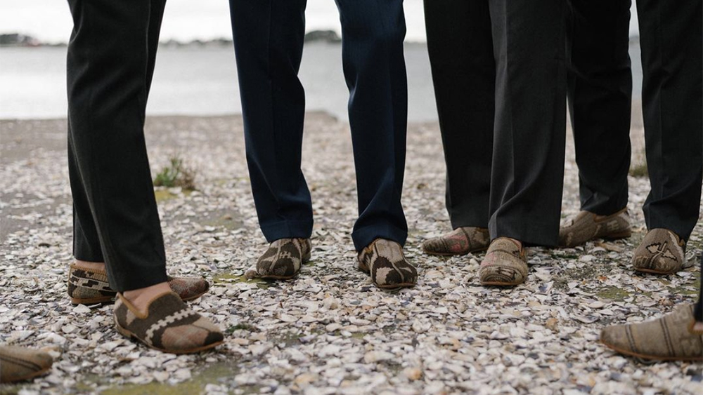 A wedding party decked out in various pairs of kilim loafers.