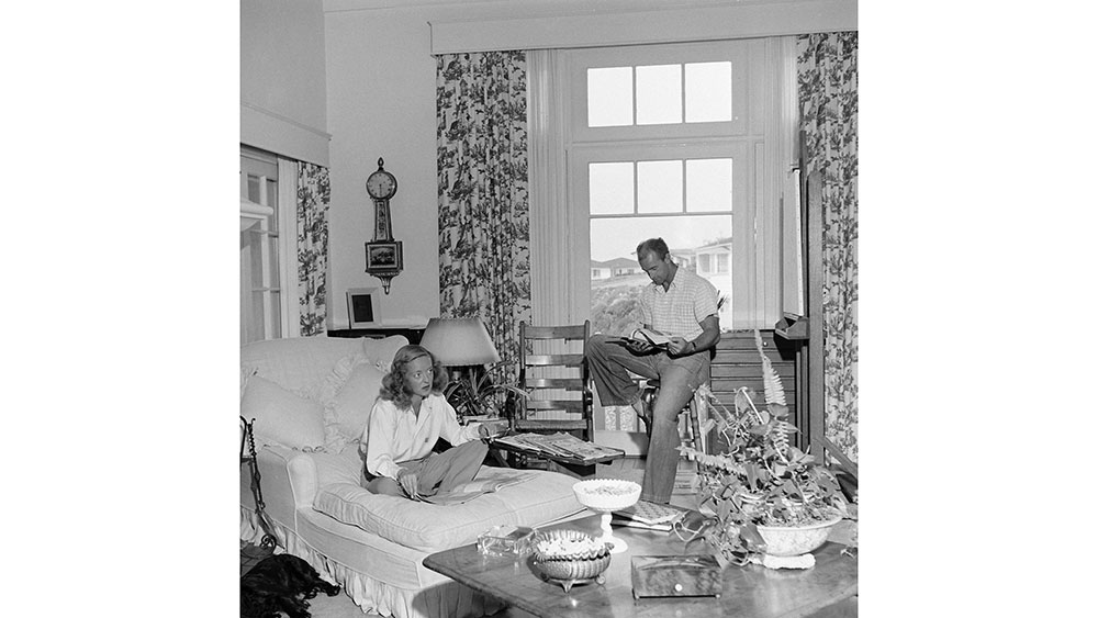 Bette Davis and her third husband, William Grant Sherry, reading in the living room of their home in Laguna Beach, California, 1947. (Photo by Loomis Dean/The LIFE Picture Collection via Getty Images)