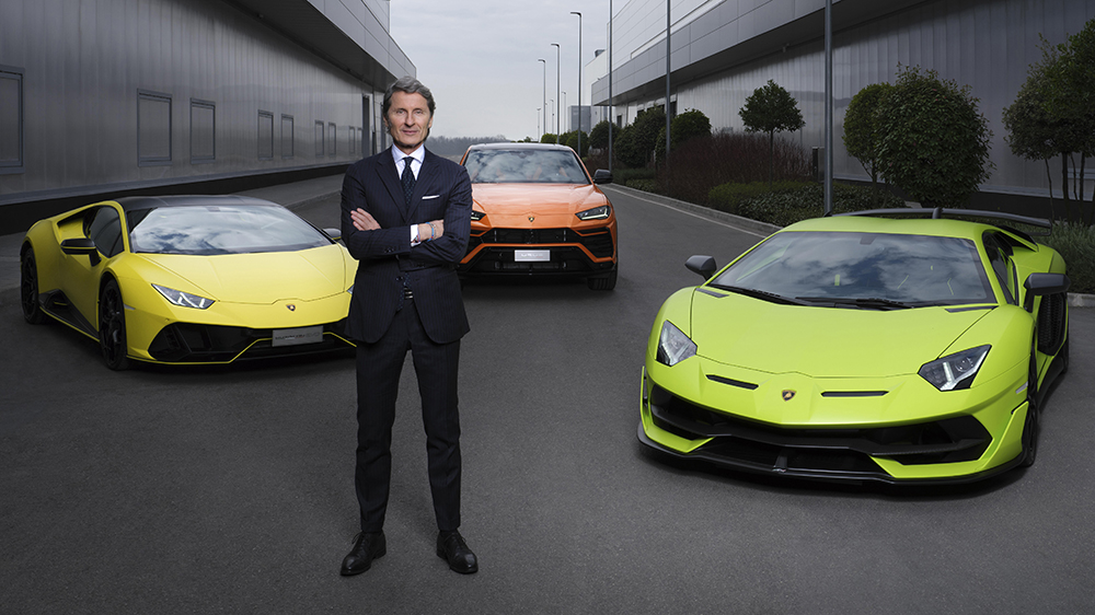 Lamborghini president and CEO Stephan Winkelmann in front of the Huracán, Urus and Aventador