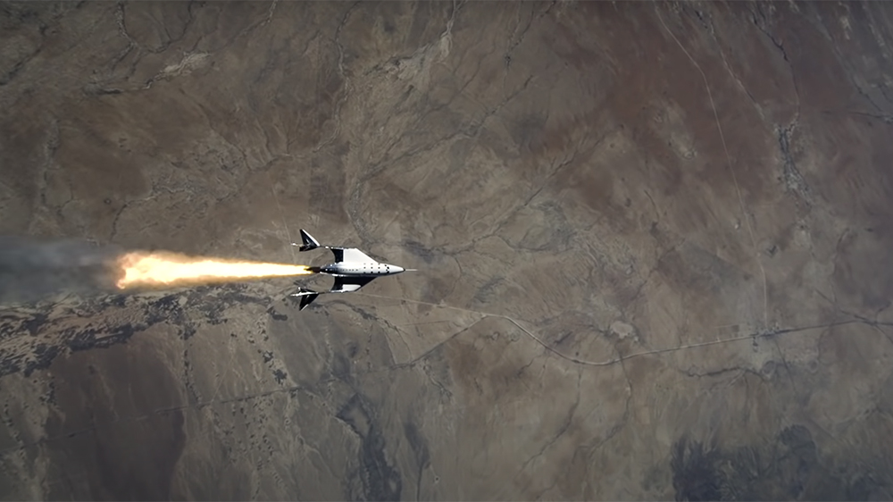The VSS Unity fires its rocket engine over New Mexico