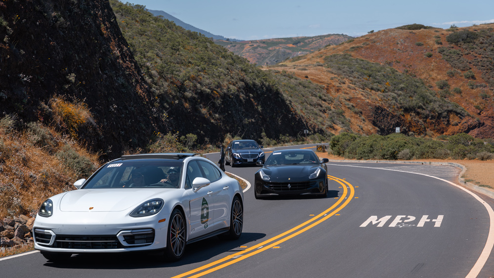 Cars in a road rally on Pacific Coast Highway.