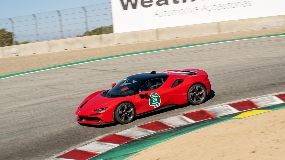 Edward Walson and his 2021 Ferrari SF90 Stradale entering the Corkscrew at Weathertech Raceway Laguna Seca.