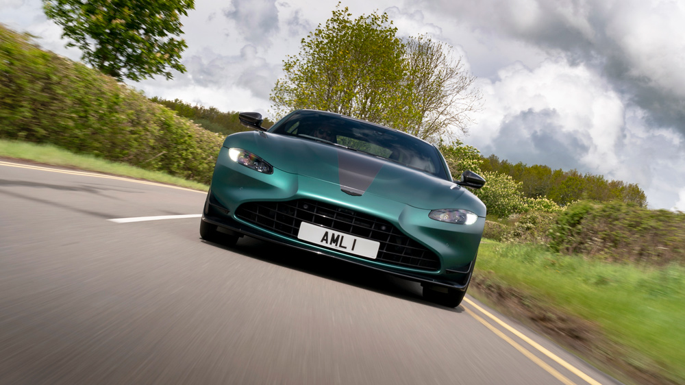 The Aston Martin Vantage F1 Edition cruising through the English countryside.