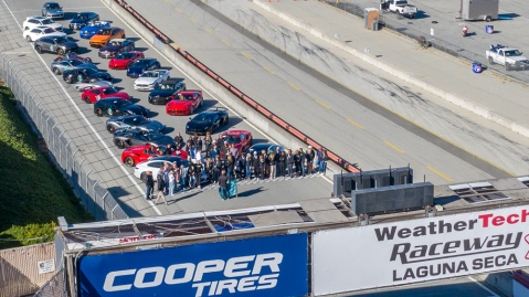 Cars in Robb Report's California Coastal road rally lined up on the track at WeatherTech Raceway Laguna Seca.
