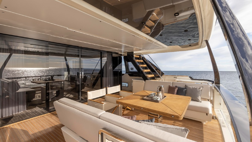 """There are defining moments in every brand, and for the Ferretti Group, that came last week with the launch of the Ferretti Yachts 1000. The Italian builder's new flagship is not only the largest boat it has ever built, but its design is part of a new revolution taking place in the 90- to 110-foot motoryacht segment. Its main competitors, Azimut and Princess, have recently launched models in the range, and both share the Ferretti's """"wide-body"""" approach, which essentially means packing a third more interior volume into the same length of hull. The Azimut Trideck and Princess X95 are both successful designs, though the profiles are more radical-looking than the Ferretti 1000, which has a more traditional look. Stefano de Vivo, Ferretti Group's chief commercial officer told Robb Report during a tour of the 1000 that it was a """"crucial"""" new design. """"It will be a template for other models going forward,"""" he said. """"At the same time, the 1000 is not an urban apartment on the water. It's modern and minimalist, but definitely marine."""" The design team, including Ferretti's Filippo Salvetti, who penned the exterior and IdeaeItalia, which created the interior, focused on presenting the brand's yachting heritage. """"We may have gone a little far with earlier models,"""" says De Vivo, referring to the residential look of other yachts in the line. While larger interior volumes are in high demand with new boaters, there are challenges. The first is keeping the profile from looking bloated. Salvetti did a good job with that by creating a top deck that looks slender, along with a larger hull body defined by racy, angular dark windows that give the impression of performance. The second is actually divvying up the unusually large interior volume so it's proportional to its actual function within the yacht. That extra-large salon might seem like a big benefit, but if it seems like a vast empty space that sacrifices galley size, for instance, then the boat doesn't function properly. I didn't se"""