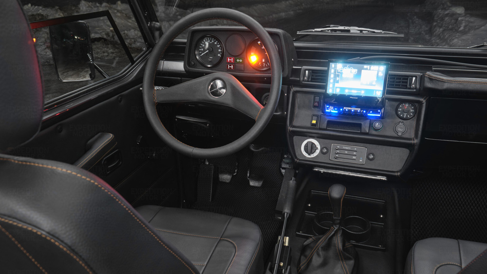 The interior of a Mercedes-Benz G-Wagen Wolf restomod from Expedition Motor Company.