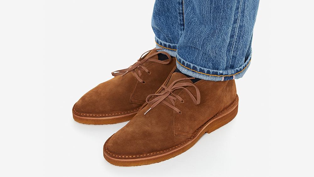 A crepe-soled desert boot worn casually with jeans.