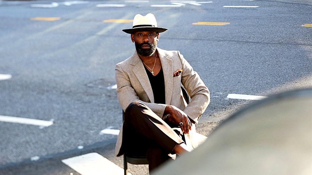 A model wearing a FlameKeepers Hat Club straw Panama hat.
